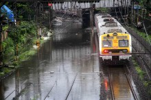 Heavy Rain Lashes Mumbai; Local Trains, Road Traffic Hit Due To Water-logging