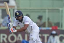 Rohit, Pujara Steady India After Anderson's Strike