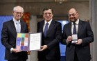 From left, European Council President Herman Van Rompuy, European Commission President Jose Manuel Barroso and European Parliament President Martin Schulz with the Nobel diploma on the podium at the City Hall, Oslo, during the Nobel Peace Prize ceremony.