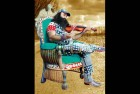 <b>Play it again...</b> Baba Ram Rahim in a still from <i>MSG</I>