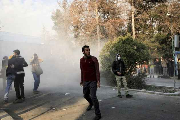 Iran Unrest Continues, Protesters Try To Overrun Military Bases, Police Stations, At Least 13 Dead
