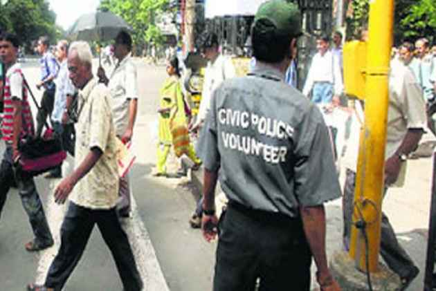 West Bengal Civic Police Volunteers Beat Helmetless Biker To
