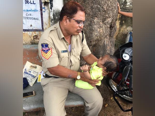 Telangana Police Babysits Infant While Mother Takes Exam