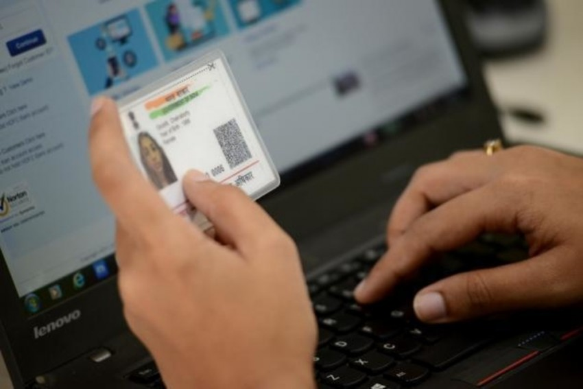 Cabinet Gives Nod To Make Aadhaar Voluntary For Mobile Numbers, Bank Accounts