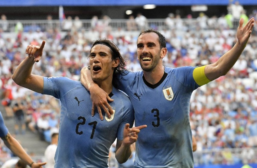 Uruguay Win Group As Suarez Inspires 3-0 Win Over 10-Man Russia