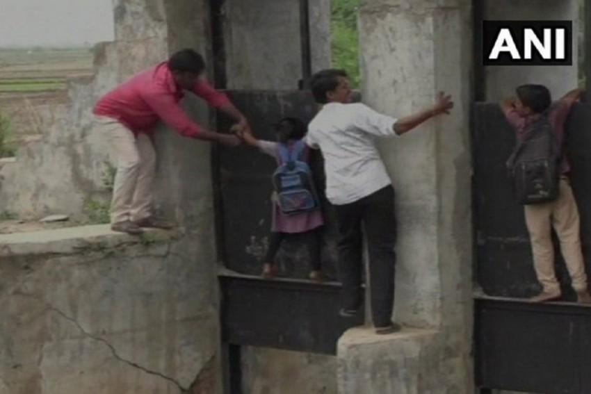 Watch Video: Gujarat Locals Risk Lives, Cross Canal Through Collapsed Bridge
