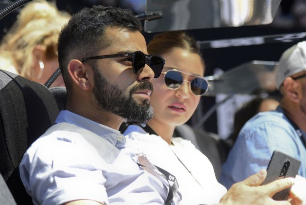 Virat Kohli Jets Off With Wife Anushka Sharma – Photo