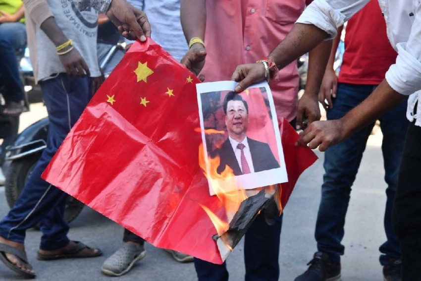 Chinese Flags Burnt In Guwahati As Xi Jinping Arrives In India