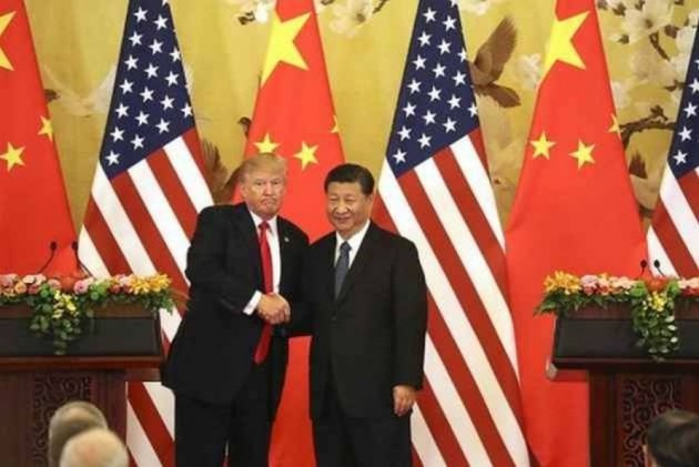 US Team In Beijing For Crucial Trade Talks After IMF 'Storm' Warning