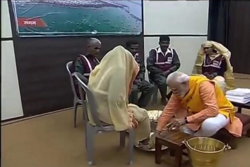 PM Modi Washes Feet Of Sanitation Workers At Kumbh