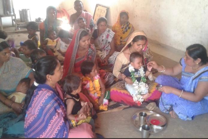 Spreading awareness about complementary feeding by celebrating annaprasan divas at a Anganwadi centre at Dindori, Madhya Pradesh