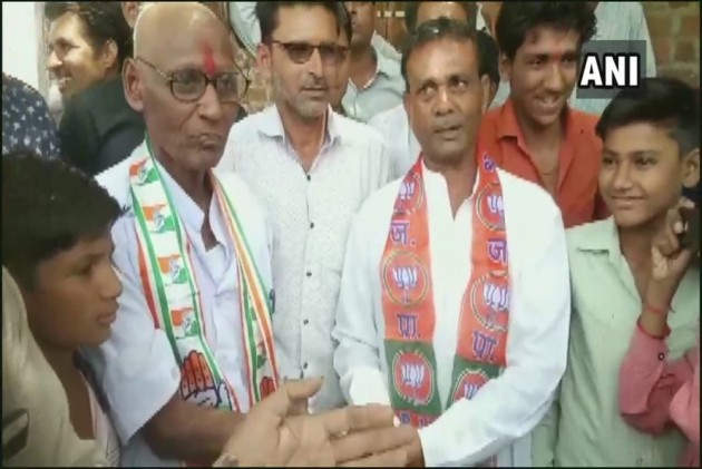 MP Congress Worker Shaves Head After Losing Bet To BJP Worker