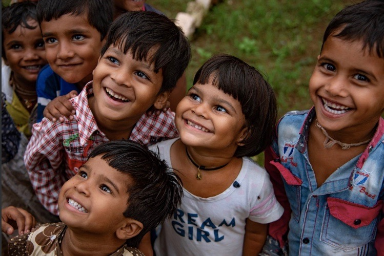 Children smile for the cameras at an Anganwadi centre