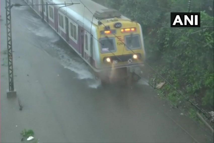 Mumbai Rains :Railways Tracks Submerged, Trains Rescheduled Due To Heavy Downpour