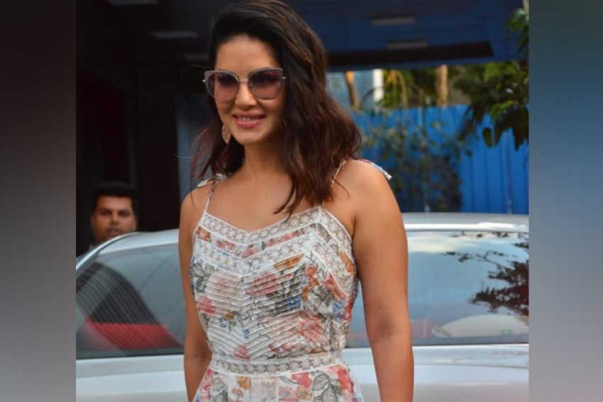 Sunny Leone Makes Heads Turn In A Stylish Appearance In The City