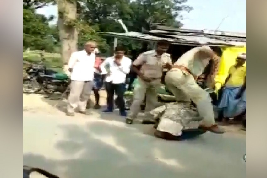 UP Policemen Caught On Camera Assaulting Young Man, Suspended