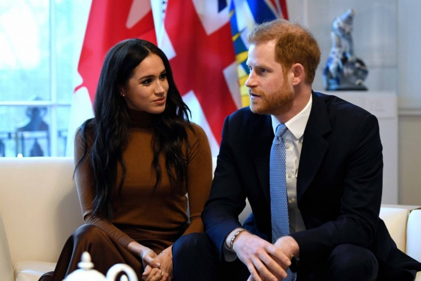 Britain's Prince Harry, Wife Meghan To Give Up 'Royal Highness' Titles