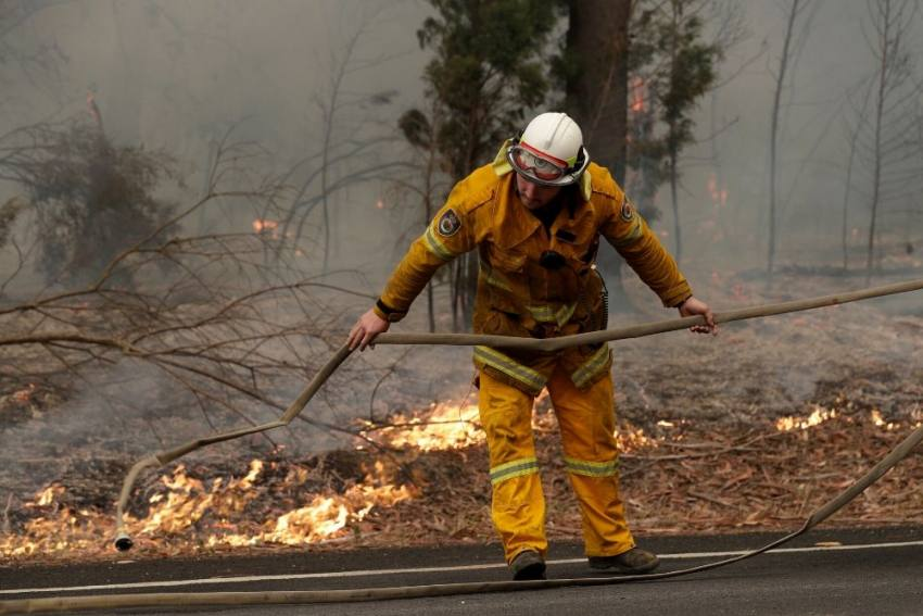 Australia Firefighters Race To Contain Blazes As Heatwave Looms