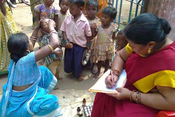 Aanganwadi worker taking a survey