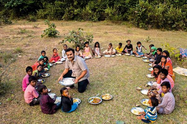 Chandra Sekhar Kundu serves a wholesome meal to children