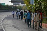 'Shoot Us Or Send Us Home': Migrants Struggle To Return As Punjab, Haryana Shift Blame