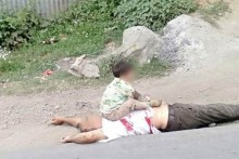 Who Clicked Photos Of Kashmiri Child Sitting On Bullet-riddled Body Of His Grandfather?