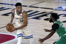 NBA: Giannis Antetokounmpo Leads Milwaukee Bucks Past Boston Celtics, James Harden Stars