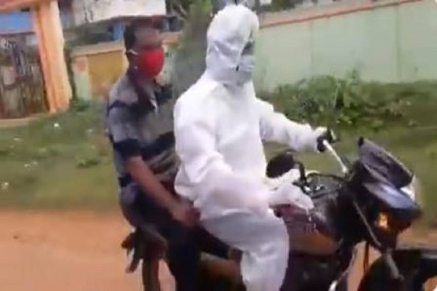 Wearing PPE Kit, TMC Leader Takes Man With COVID Symptoms To Hospital On Bike