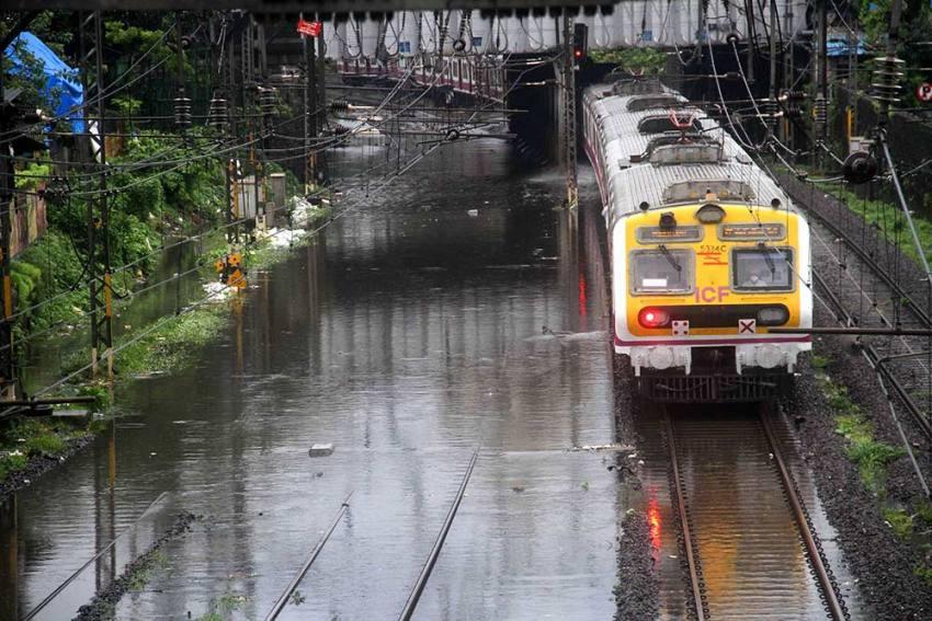 Heavy Rain Lashes Mumbai; Local Trains, Road Traffic Hit Due To Water-logging