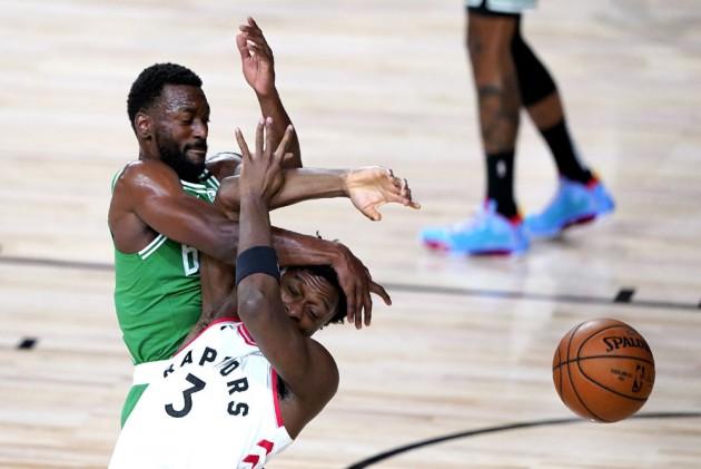 Nba Results Celtics Dominate Raptors As Nets Magic Clinch Playoff Spots
