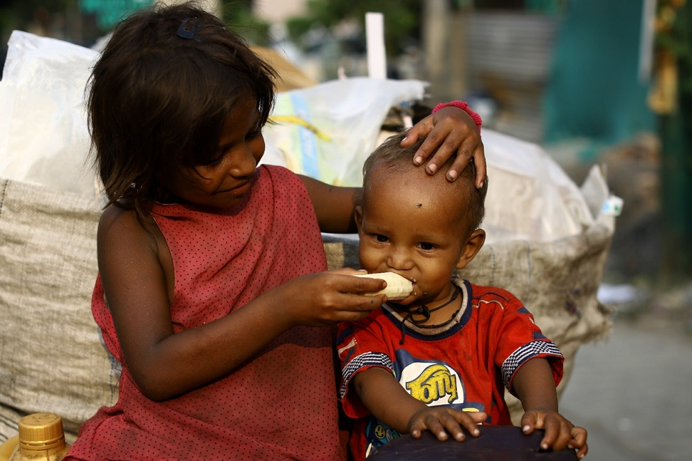A child feeding another child