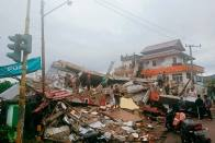 At Least 42 Dead As Indonesia Quake Topples Homes, Buildings