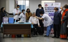 Manish Kumar, A Sanitation Worker At AIIMS Becomes The First To Receive Covid-19 Vaccine In Delhi
