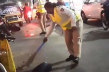Video Of Woman Cop Sweeping Road To Remove Broken Glass Pieces Goes Viral