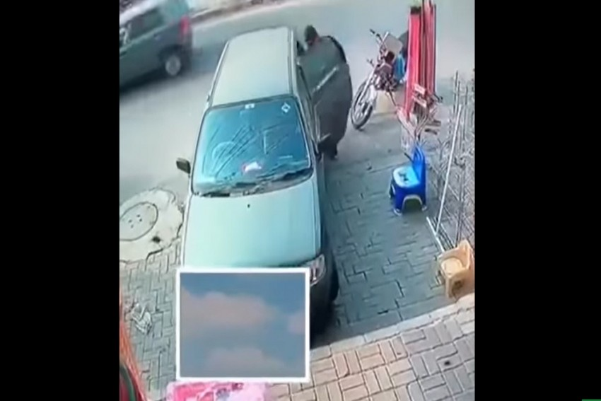 Watch: Shocking Video Of Thief Stealing From Parked Car Goes Viral