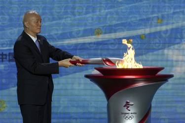 Olympic Flame Arrives In Beijing For Winter Games Amid Boycott Calls