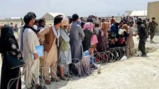 US: Secrecy Continues About Small Group Of Afghan Refugees Sent To Overseas Base In Kosovo