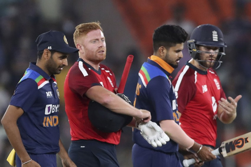 England's Jonny Bairstow, second left, and Dawid Malan, right, walk off the field with Indian players after the end of 1st T20I match at Narendra Modi Stadium in Ahmedabad