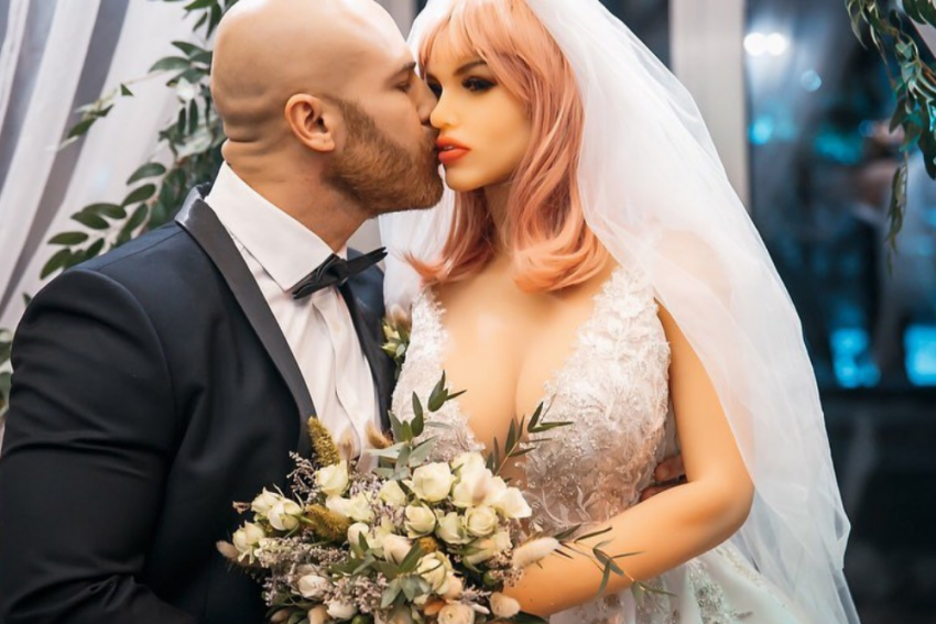 Kazakh Bodybuilder Yurii Tolochko 'Marries', Then 'Divorces' Sex Doll, Finds New Sex Doll As 'Wife'