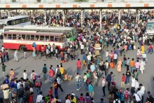 In Pics: Migrants Rush Home As Delhi Enters Lockdown, Massive Crowds At Bus Stands