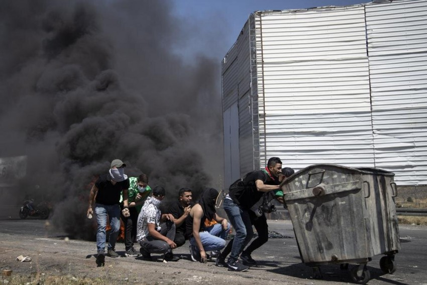 Israeli Airstrike On Gaza House Kills 10, West Bank Erupts In Protest