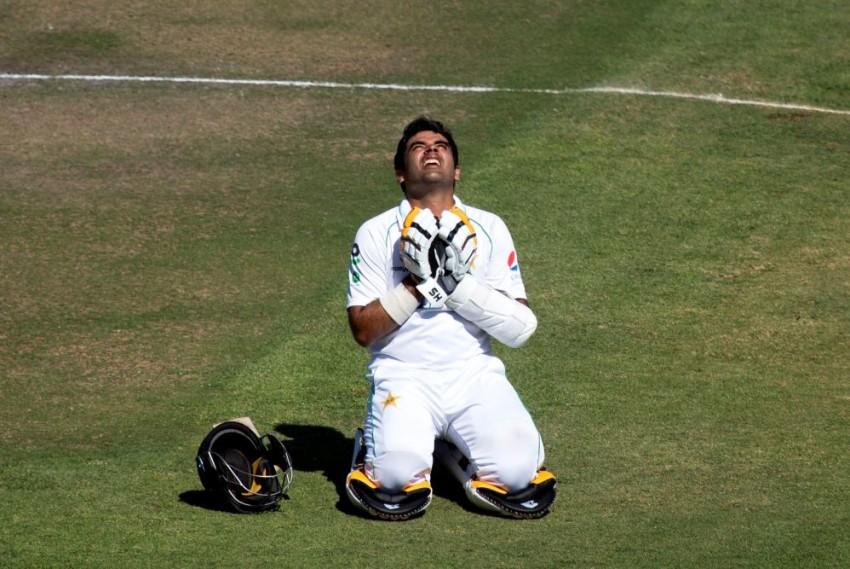 Pakistan batsman Abid Ali celebrates after scoring 200 runs during the second test cricket match against Zimbabwe at Harare Sports Club, Zimbabwe on Saturday.
