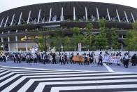 Two Tokyo Olympics: Inside And Outside National Stadium