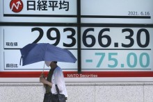 Ahead Of US Federal Reserve Meet, Asian Shares Mixed In Quiet Trading On Wednesday