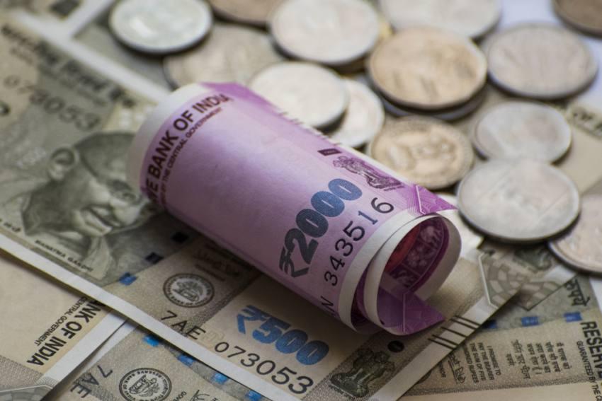 Rupee Slumps 76 Paise, Settles Below 74/USD