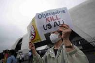 'Go Home!'  Anti-Olympic Protesters Demonstrate Against IOC In Tokyo