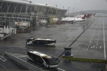Typhoon In-Fa Makes Landfall In China, Hundreds Of Flights Cancelled