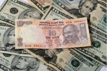 Rupee Gains 9 Paise To Close At 74.29 Against US Dollar