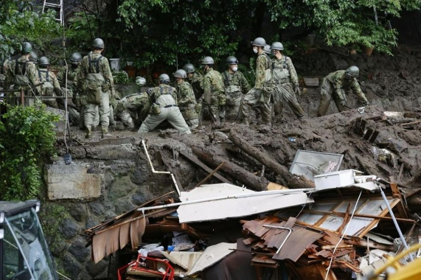 Japan: Rescue Workers Search For Dozens Of Missing In Resort Town Mudslide