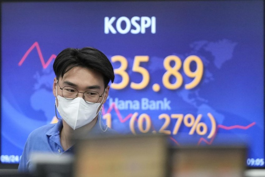 Asian Shares Mixed On China Developer, Virus Concerns